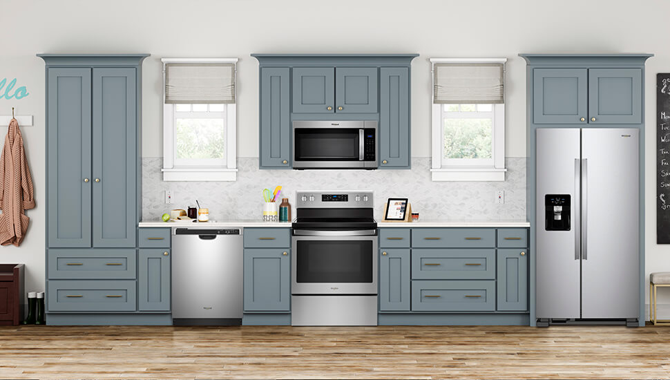 Kitchen With Blue-Gray Cabinets and Stainless Steel Whirlpool Appliances