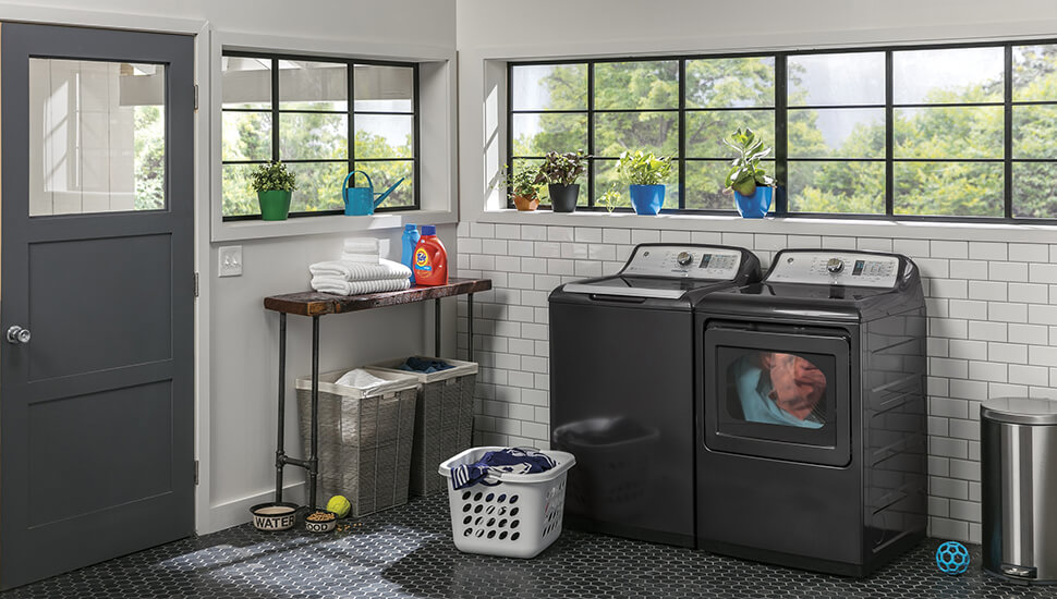 black stainless washer and dryer in laundry room